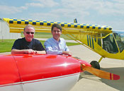 EAA's Tom Poberezny (left) with Sebastien Heintz of Zenith Aircraft Co.